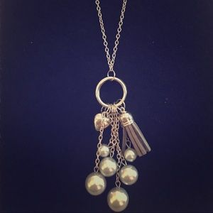 Long, silver necklace